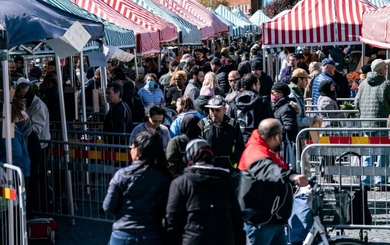 People walk at a market as the city of Malmo, Sweden, where fences reduce congestion at the stands on April 25. (Johan Nilsson/EPA-EFE/Shutterstock)