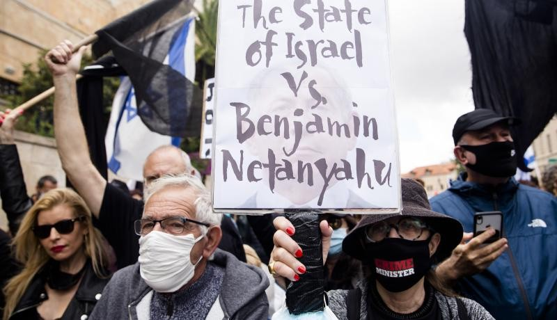 Israelis protest against Benjamin Netanyahu, who denies charges of bribery, fraud and breach of trust. Photo by Amir Levy/Getty Images.