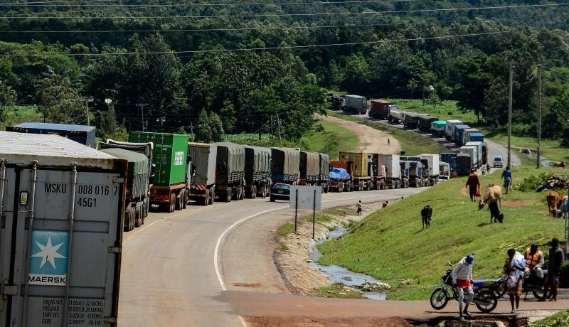 Truck drivers wait to be tested for COVID-19 on the road to enter Uganda in Malaba, a city containing the border with Kenya. Photo by BRIAN ONGORO/AFP via Getty Images.