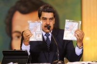 Venezuelan President Nicolás Maduro showed the passports of two U.S. citizens arrested by his country's security forces during a press conference at the Miraflores Presidential Palace in Caracas on May 6. (Marcelo Garcia/AFP/Getty Images)