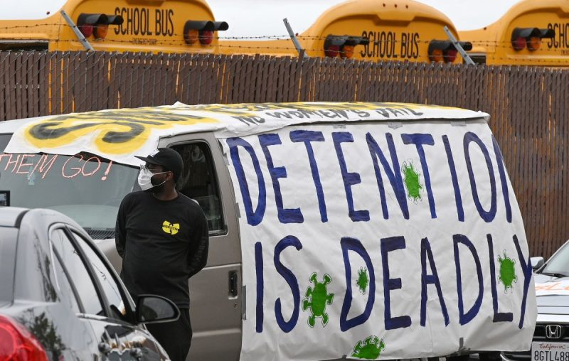 Human rights activists prepare for a car caravan protest through downtown Los Angeles to call on officials to release inmates from jails to prevent the spread of coronavirus on April 7. (Robyn Beck/Afp Via Getty Images)