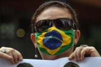 A supporter of President Jair Bolsonaro takes part in a protest in Sao Paulo, Brazil, on May 1, over the quarantine and social distancing measures imposed to combat the coronavirus. (Nelson Almeida/AFP/Getty Images)