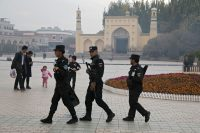 Uighur security personnel patrol near the Id Kah Mosque in Kashgar in western China's Xinjiang region in November 2017. (Ng Han Guan/AP)