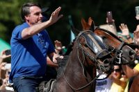 President Jair Bolsonaro riding a horse during an event with supporters in Brasília on Sunday. Credit Ueslei Marcelino/Reuters