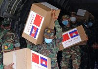 Medical supplies donated by the Chinese military being unloaded in Cambodia on Tuesday. Credit Mak Remissa/EPA, via Shutterstock