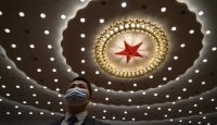 A Chinese security officer wears a protective mask at the end of the closing session of the National People's Congress at the Great Hall of the People. Photo by Kevin Frayer/Getty Images.