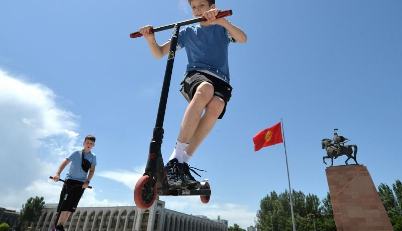 Boys ride scooters during International Children's Day (June 1) at the central Ala-Too Square in Bishkek, Kyrgyzstan. Photo by VYACHESLAV OSELEDKO/AFP via Getty Images.