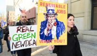 Demonstrators with placards during a protest in New York City to support the Green New Deal. Photo by Michael Brochstein/SOPA Images/LightRocket via Getty Images.
