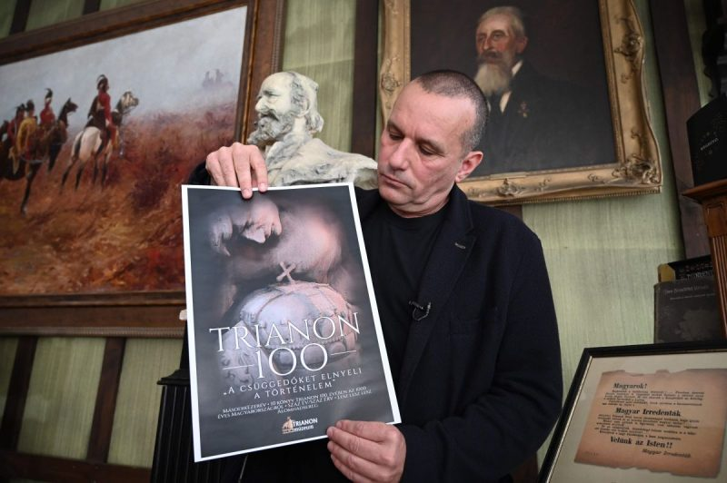 Csaba Pal Szabo, director of a state-financed Trianon Museum, shows a poster during an interview with AFP journalists on May 25 in Szeged, Hungary. (Attila Kisbenedek/AFP/Getty Images)