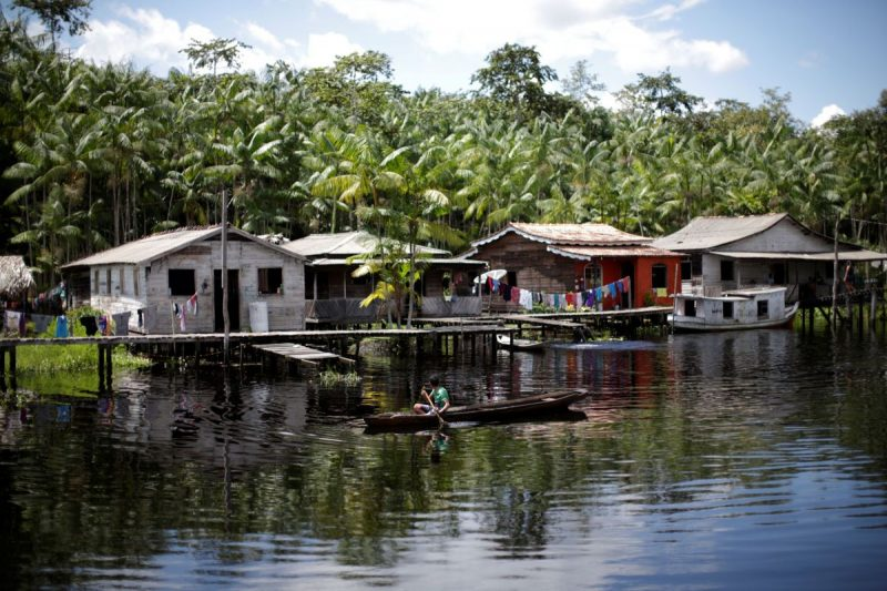Houses stand along the river of the Santo Ezequiel Moreno community, during the novel coronavirus outbreak, in the municipality of Portel, on Marajo island, Para state, Brazil, on June 5. (Ueslei Marcelino/Reuters)