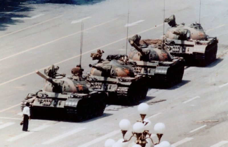 """The now-iconic image of """"Tank Man,"""" a pro-democracy protester in Tiananmen Square, Beijing, on June 5, 1989. Credit Jeff Widener/Associated Press"""