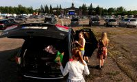 A drive-in concert in Riga, 11 June 2020. 'Latvia has one of the lowest Covid-19 infection and mortality rates in the EU, thanks to aggressive contact tracing.' Photograph: Ints Kalniņš/Reuters