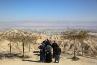 People gather in the Jewish settlement of Mitzpe Yeriho overlooking the West Bank city of Jericho on Jan. 26. (Oded Balilty/AP)