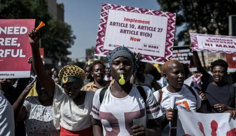 Women hold signs during a protest against repeated failures to apply laws that women must hold at least a third of government seats in Nairobi, Kenya, on 22 January 2018. According to Kenya's 2010 constitution, women must have at least a third of seats in parliament and a third of appointed positions. Photo: Getty Images.
