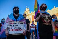 Protesters in protective masks demonstrate against discrimination of the LGBT community two days before the presidential elections runoff at the UNESCO listed Main Square on July 10 in Krakow, Poland. (Omar Marques/Getty Images)