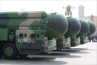 Military vehicles carrying DF-41 intercontinental nuclear missiles during a parade in Beijing last October. China plans to soon introduce an air-launched ballistic missile delivered by heavy bombers. Credit Wu Hong/EPA, via Shutterstock