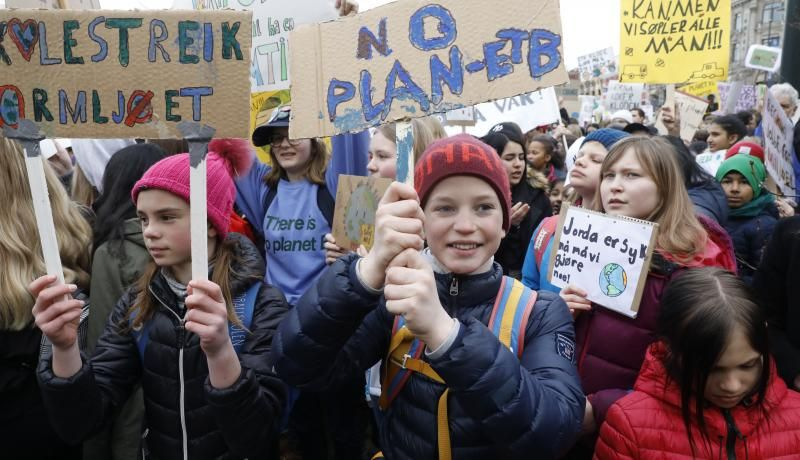 Students gather to protest inaction on climate change in front of the parliament building in Oslo, Norway on 22 March 2019. Photo: Getty Images.
