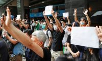 Hongkongers raise blank papers after slogans were banned. Photograph: Tyrone Siu/Reuters