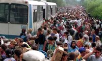 Refugees fleeing Bosnian Serb troops gather at Tuzla airport, eastern Bosnia, in July 1995. Photograph: Wade Goddard/Reuters