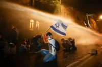 Israeli police use a water cannon to disperse people during a protest against Israeli Prime Minister Benjamin Netanyahu In Jerusalem on July 18. (Oded Balilty/AP)
