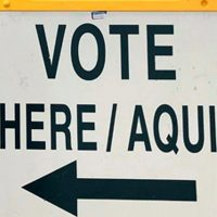 A sign in English and Spanish directs voters to an early-voting location in Surprise, Ariz., in April 2018. (Anita Snow/AP)
