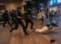 Police officers clashing with protesters at a shopping mall in Hong Kong on July 1. Credit Lam Yik Fei for The New York Times