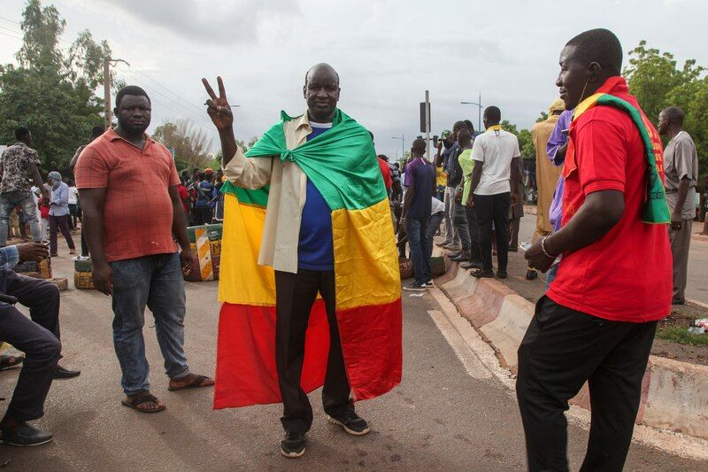 Anti-government protesters demonstrate in the Malian capital of Bamako on July 10. (Baba Ahmed/AP)