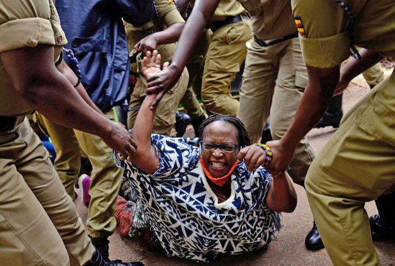 Ugandan police detaining the academic Stella Nyanzi for protesting against the way that government distributes the relief food and the lockdown situation to control the spread of the coronavirus disease (COVID-19) outbreak in Kampala, Uganda, in May. Credit Reuters