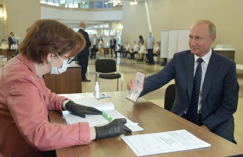 Alexei Druzhinin/TASS via Getty Images President Putin presenting his identification document to validate his vote in Russia's constitutional amendment referendum that would permit him to remain president until 2036, Moscow, July 1, 2020