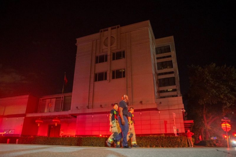 Firefighters responding to a fire at the Chinese Consulate in Houston on July 21. Credit Mark Mulligan/Houston Chronicle, via Associated Press