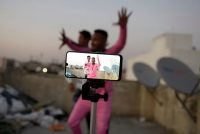 People making a TikTok dance video on the terrace of their residence in Hyderabad, India. Credit Noah Seelam/Agence France-Presse — Getty Images