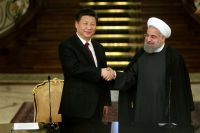 President Xi Jinping of China, left, and President Hassan Rouhani of Iran concluding a joint news conference in Iran in 2016. Credit Ebrahim Noroozi/Associated Press