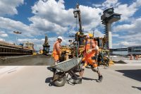 Workers at the Berlin Brandenburg Airport, which is under construction in Germany. Credit Hayoung Jeon/EPA, via Shutterstock