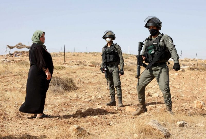 Israeli soldiers interacting in the West Bank last month with a Palestinian woman protesting the demolition of an unapproved animal shed. Credit Abed Al Hashlamoun/EPA, via Shutterstock