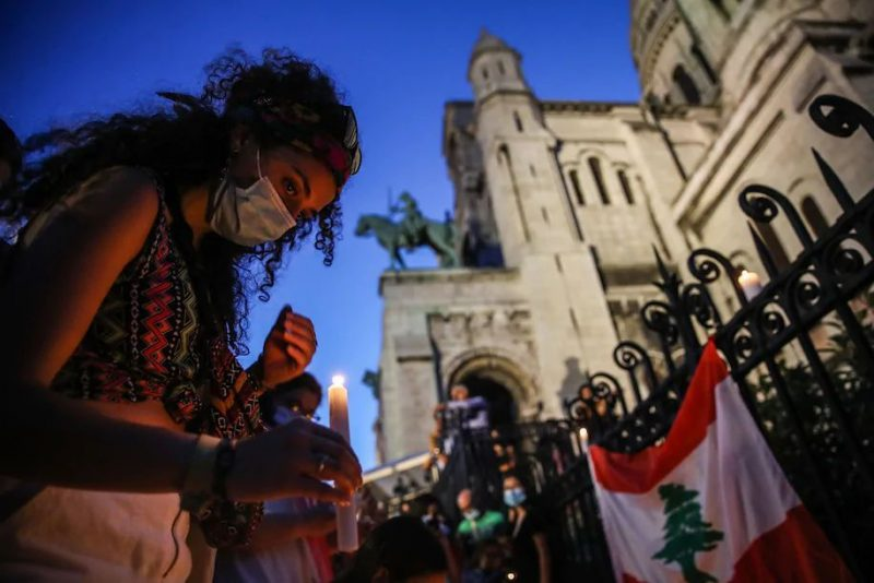 People light candles during the Solidarity Stand event, held to show solidarity with the victims of blasts in Beirut, next to the Basilica of the Sacred Heart in Paris on Wednesday. (Mohammed Badra/EPA-EFE/REX/Shutterstock)