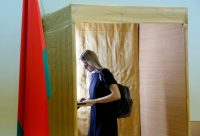 A woman votes during preterm balloting at a polling station in Minsk, Belarus, on Friday. The presidential elections in Belarus will be held Sunday. (Tatyana Zenkovich/EPA-EFE/Shutterstock)