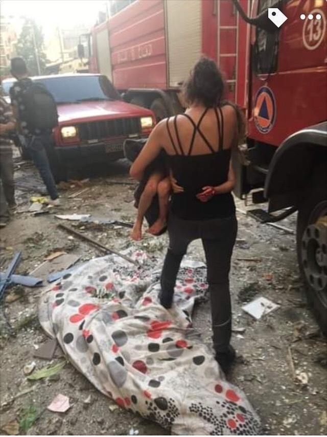The author carrying her daughter to an ambulance, Beirut, August 4, 2020. Seema Jilani/Dion Nissenbaum