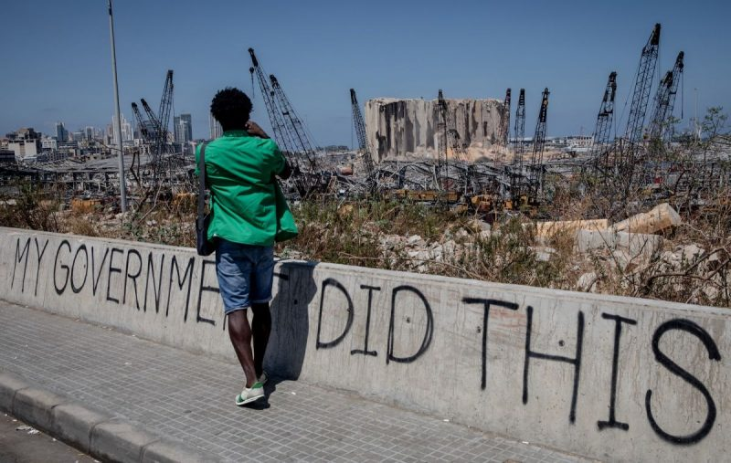 A man taking a photograph of the destroyed Beirut port, Lebanon, August 16, 2020. Chris McGrath/Getty Images