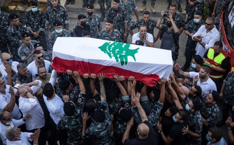 The coffin of firefighter Ralph Malahi, who was killed in the August 4 explosion, being carried to his funeral by friends and colleagues from the Karantina Fire Department, Beirut, Lebanon, August 15, 2020. Chris McGrath/Getty Images