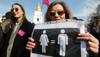 Ukrainian feminists and human rights activists carry posters at an International Women's Day protest in Kyiv, Ukraine on 8 March 2019. Photo: Getty Images.