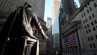A statue of George Washington is pictured in front of the New York Stock Exchange (NYSE) on 16 March 2020, at Wall Street in New York City. Photo by JOHANNES EISELE/AFP via Getty Images.