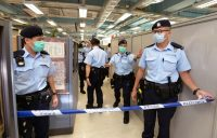 Police cordoned off the headquarters of the tabloid Apple Daily after Mr. Lai's arrest. Credit Getty Images