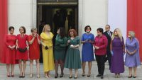 Polish lawmakers dressed in rainbow colours to show support for the LGBT community, ahead of the swearing in ceremony of President Andrzej Duda for a second term Photograph: Czarek Sokołowski/AP