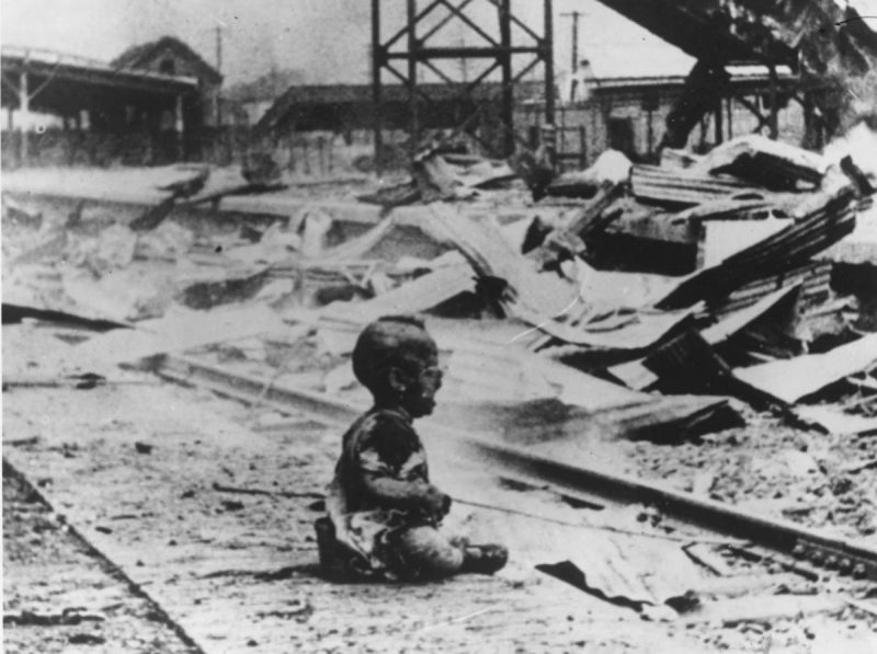 "In a photograph known as ""Bloody Saturday,"" a crying child sits in the bombed-out ruins of Shanghai South Railway Station after a Japanese air attack in 1937. (H.S. Wong/Getty Images)"