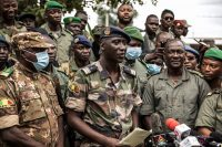 Colonel-Major Ismael Wague, center, the spokesman for the soldiers identifying themselves as the National Committee for the Salvation of the People, holds a news conference at Camp Soudiata in Kati, Mali, on Wednesday. (AP)