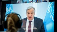 United Nations Secretary-General Antonio Guterres is seen on a video screen during a virtual climate summit, known as the Petersberg Climate Dialogue, in Berlin on 28 April 2020. Michael Kappeler/Pool via REUTERS