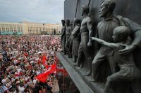 Belarusian opposition supporters protest in front of the government building Tuesday at Independence Square in Minsk. (Dmitri Lovetsky/AP)