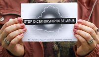 People protest at a rally of solidarity with political prisoners in Belarus. Photo by Beata Zawrzel/NurPhoto via Getty Images.