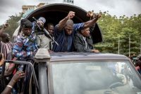 Security forces drive through the Mali capital of Bamako on Wednesday, a day after soldiers fired into the air outside President Ibrahim Boubacar Keïta's home and took him into custody. (AP)