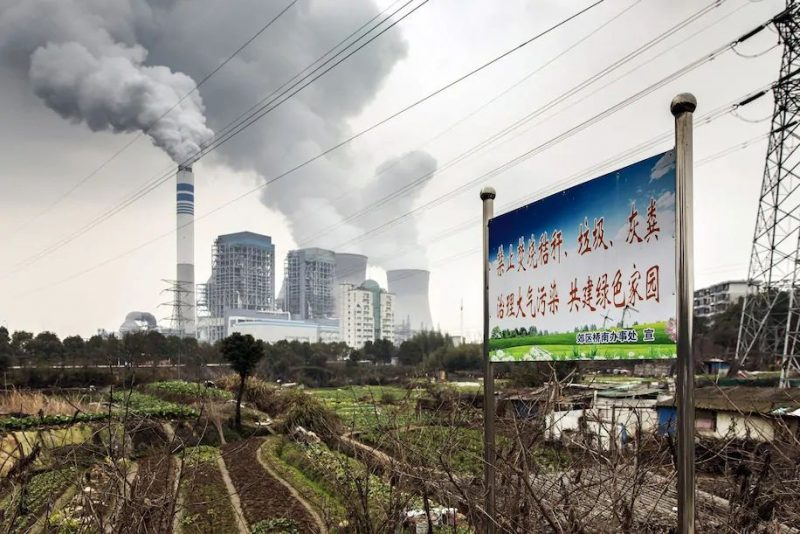 Emissions rise from cooling towers at a coal-fired power station in Tongling, China. (Qilai Shen/Bloomberg News)